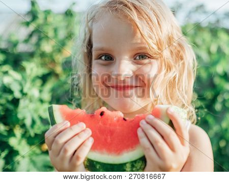 Child Eating Watermelon Outdoors. Healthy Snack For Children. Little Girl Holding A Slice Of Ripe Re