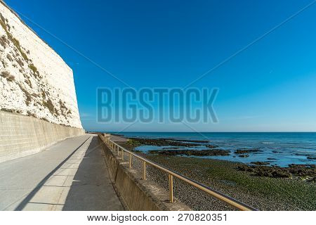 Saltdean Beach Seafront And White Sandstone Chalk Cliffs With Walkway For People Exercise. Underclif
