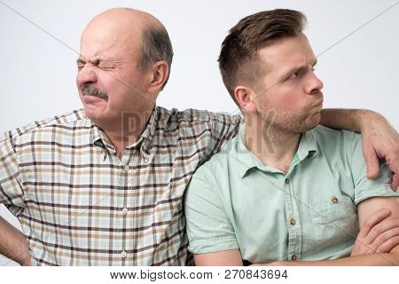 Two Mature Men Father And Son Are Offended On Each Other. Have A Disagreement