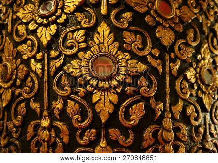 Gorgeous Gold And Black Vintage Thai Pattern On The Teak Lacquered Pillar In Wat Phumin Temple, Nan