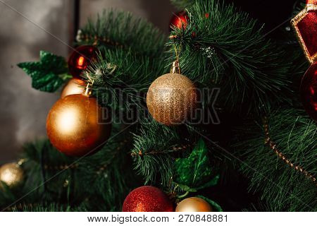 Christmas Toy On The Christmas Tree. Decorated Christmas Tree Ball. Christmas Ball Close Up. Selecti