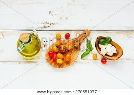 Tomato Mozzarella Basil Leaves And Olive Oil Flat Lay. Italian Salad. Mediterranean Salad. Italian C
