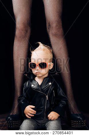 Rock It. Adorable Little Music Fan. Small Boy At Female Legs. Rock Style Child. Little Rock Star. Sm