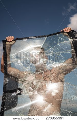 Too Much Ambition. Focus On Building Strength And Power. Strong Man Hold Cracked Glass. Sport Man Wi