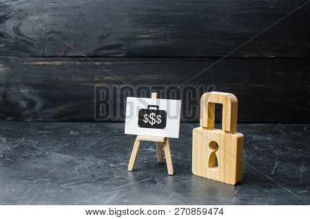 Wooden Padlock And Sign With The Image Of Investment. Protection Money Concept. Safe And Secure Inve