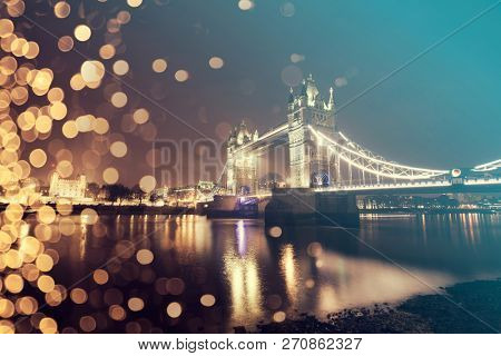 Holiday in London - Christmas background with the London bridge under snowy sky