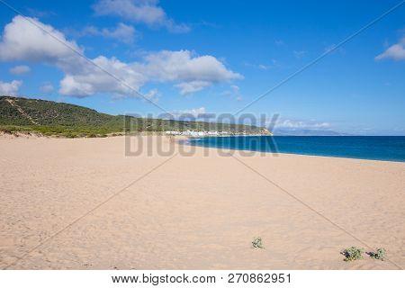 Lonely Varadero Beach And Canos De Meca Village In Cadiz