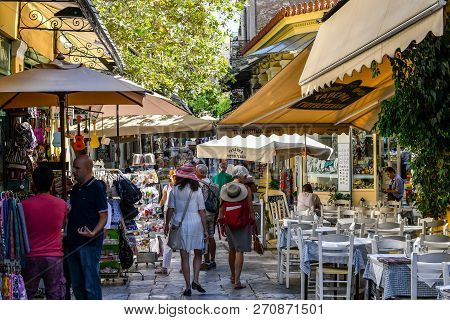 Athens, Greece - September 22 2018: Tourists Walk The Narrow Path Between Souvenir Shops And Outdoor