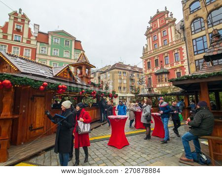 Wroclaw - Poland, November 24, 2018: People attend christmas market in old city