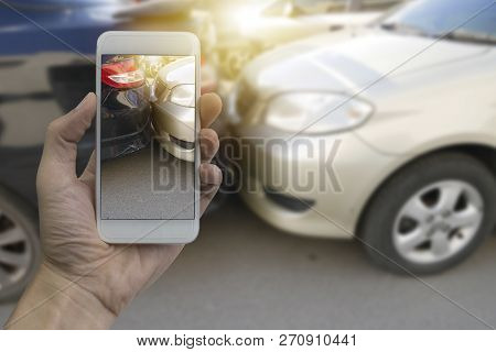 Close Up Hand Holding Smartphone And Take Photo At The Scene Of A Car Crash And Accident, Car Accide