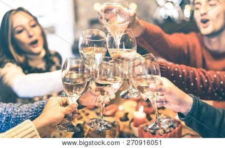 Friends Group Celebrating Christmas Toasting Champagne Wine At Home Dinner - Winter Holiday Concept