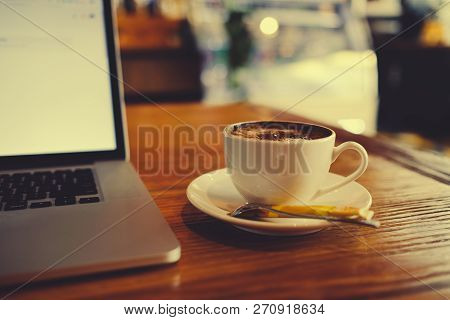 A Cup Of Cappuccino Coffee With Laptop On Table. Royalty High Quality Free Stock Image Of Capuccino