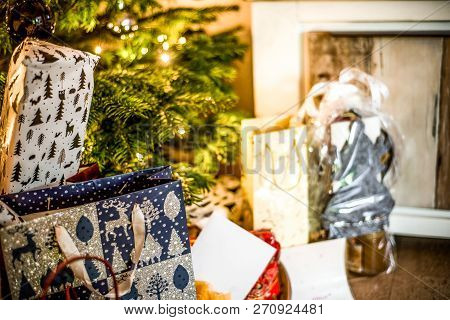 Small Handmade Gift Boxes In Shiny Colorful Night Christmas Tree Setup Background Celebration