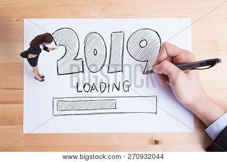 Business People Writing 2019 New Year Loading Text On The Paper And Woman Take Magnify