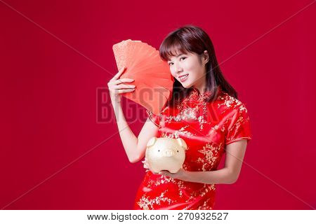 Beauty Woman Show Golden Piggy Bank And Red Envelope In Chinese New Year