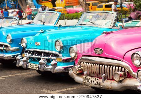 Havana, Cuba - November, 2018: Colorful Vintage Classic American Cars Parked On The Street Of Old Ha