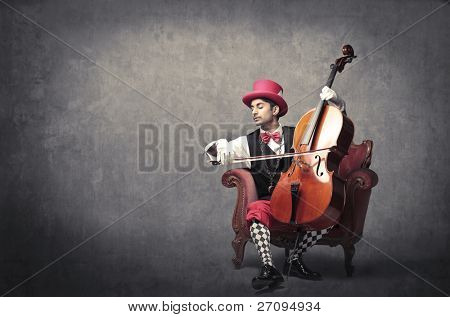 Young elegant man playing the cello