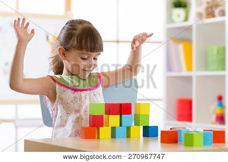 Little Girl Build Block Toys At Home Or Daycare. Cheerful Kid Playing With Color Cubes. Educational