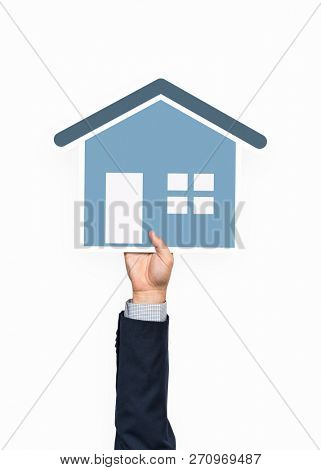Hand holding a house icon clipart