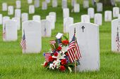 National flags and headstones in Arlington National cemetery - Washington DC, United States of America poster