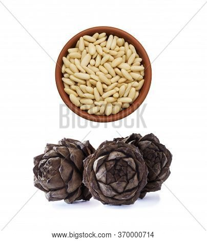 Heap Of Pine Nuts Isolated On White Background. Pile Of Pine Nuts Isolated On White Background. Pine