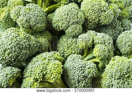 Broccoli In A Pile On A Market. Broccoli In A Pile On A Farm Stand. Fresh Broccoli In A Pile At Supe
