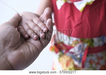 Father Holding Hand Of His Child, Close Up