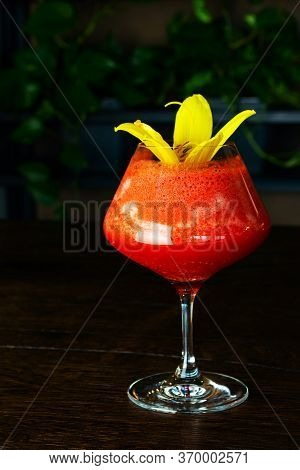 Red, Berry, Alcoholic Cocktail In A Glass Goblet On A Short Leg