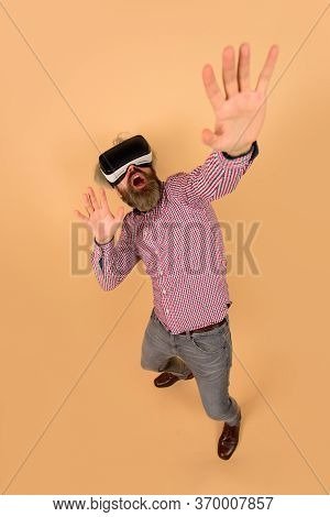 3d Goggles Virtual Reality. Attractive Man Using Virtual Reality Glasses Feeling Scary. Vr Headset.