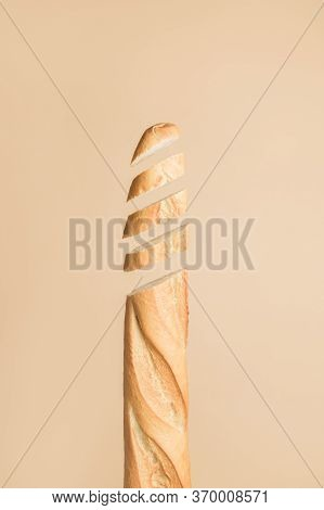 Baguette Flying In Air. Traditional Bakery Product French Baguette. Fresh Baked Bread Sliced, Cut.