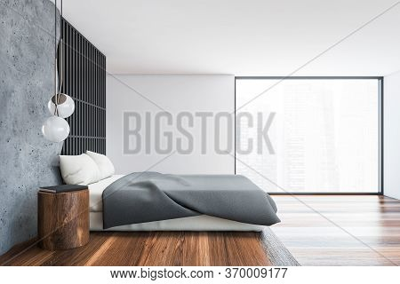 Side View Of Stylish Loft Bedroom With Gray And White Walls, Dark Wooden Floor, Comfortable King Siz