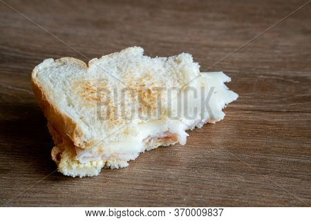 Half Eaten Sandwich Thrown On The Floor. Discarded Sandwich. Bread Tossed To The Floor. Thrown Into