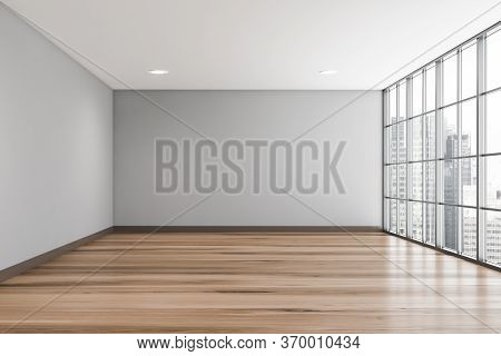 Interior Of Empty Living Room With Gray Walls, Wooden Floor And Panoramic Window With Blurry Citysca