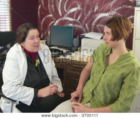 Doctor Speaking To A Young Patient