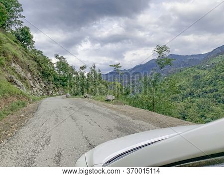 The Straight Part Of Serpentine Road In Mountains In Swat Valley. The View From The Car