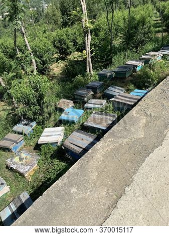 Wooden Boxes For Honey Bees Near The Road In Northern Pakistan