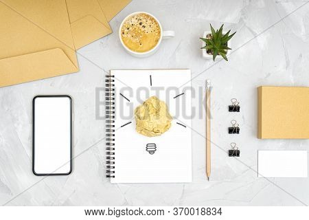 Refreshment Break Idea And Productivity Boost Concept. Flat Lay Of An Office Workplace With A Smartp