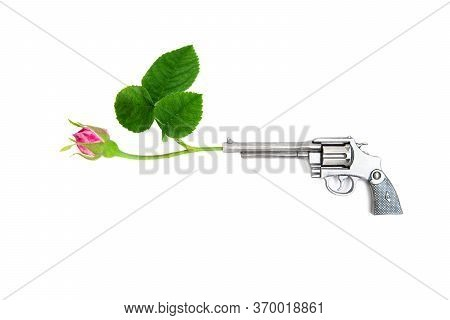 Revolver With A Red Rose In The Barrel On A White Background. Stop Violence And No War Concept.