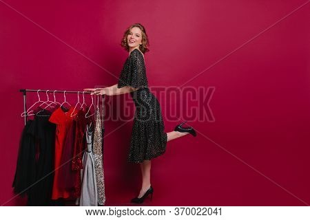 Shapely Blissful Girl Preparing For Date With Laugh. Indoor Full-length Portrait Of Funny Woman Stan