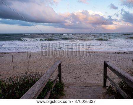 Wooden Boardwalk Leading To The Sandy Beach At The Atlantic Ocean In St. Augustine, Florida In Anast