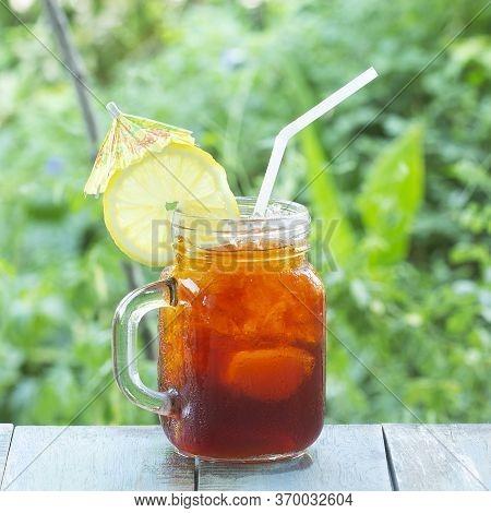 Thai Ice Tea (black Ice Tea) On The Garden Background