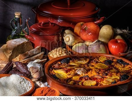 Valencian Baked Rice At Oven With Pork, Blood Sausage Garlic Tomato Saffron Vegetables. Typical Cuis