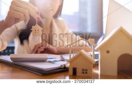 Real Estate Agents Or Sellers Of House Giving The House Keys After The Contract Was Successful On Ta