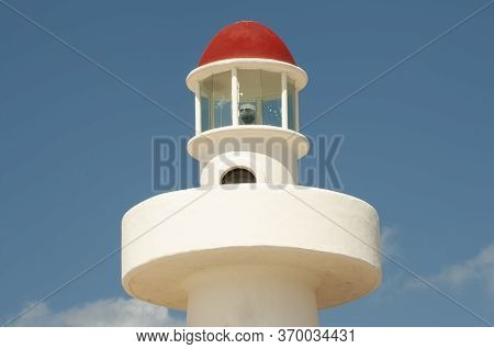 Close-up Of The Lighthouse Of Playa Del Carmen, With The Blue Sky In The Background, A Symbol Of Thi