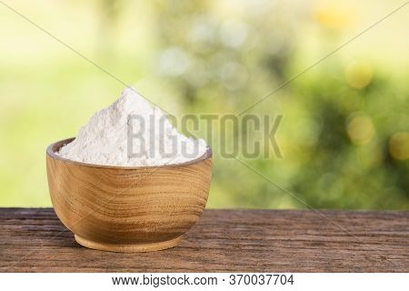 Baking Soda, Sodium Bicarbonate. Wooden Table In The Park Among The Trees On A Summer Day.