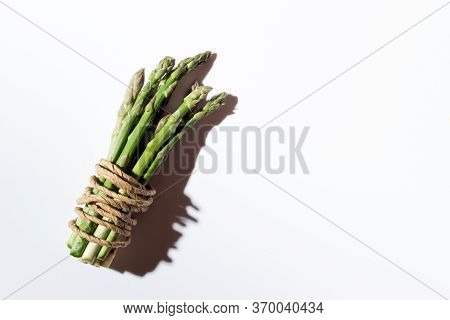 Green Fresh Asparagus On A Gray Background