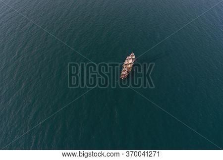 Retro Sailing Ship In Open Sea. Aerial Top View.