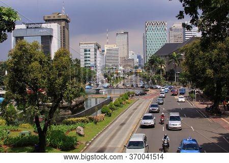 Jakarta, Indonesia - May 30, 2013: Jalan Medan Merdeka, In The Center Jakarta City Center On A Sunny