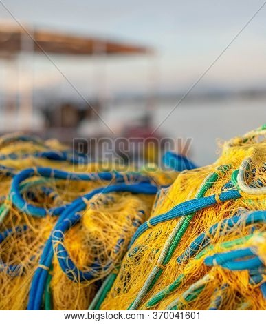 Fishing Pier With Fishing Nets At Sunrise.