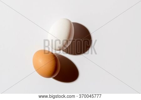 Two White Eggs Lie On A White Background